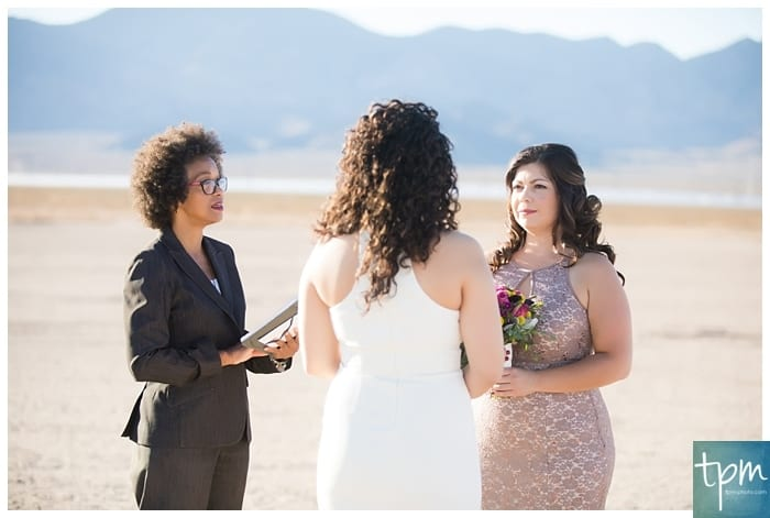 A same sex wedding with a modern minister at the dry lake beds in Las Vegas.