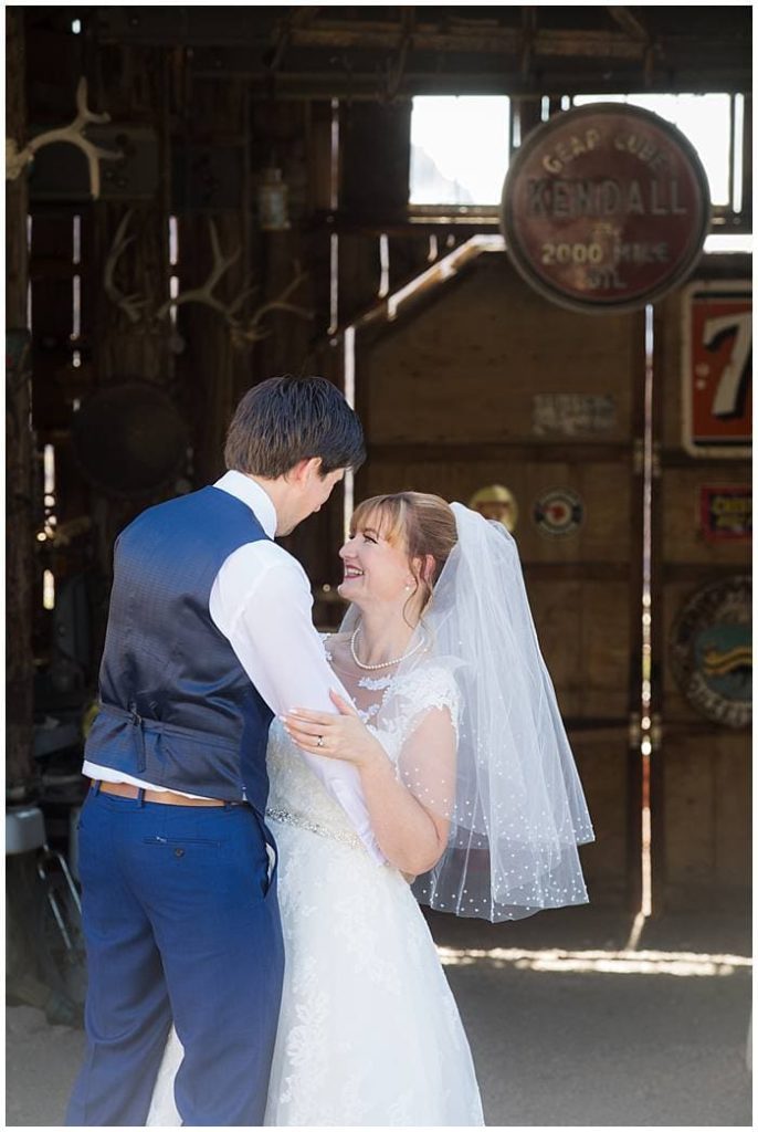 Eldorado Canyon - Groom Hugging Bride in Old Barn