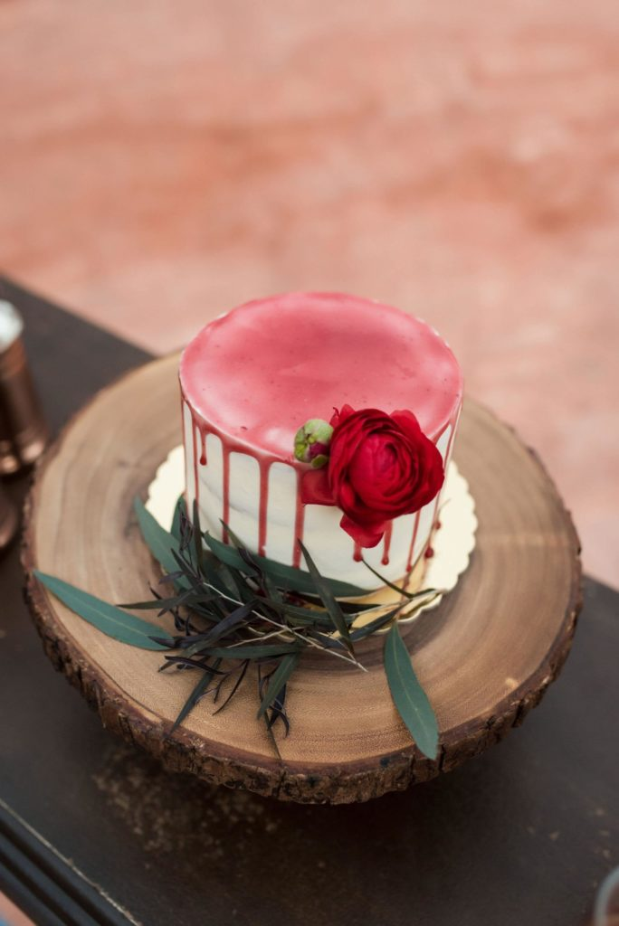 Wedding cake with red icing.