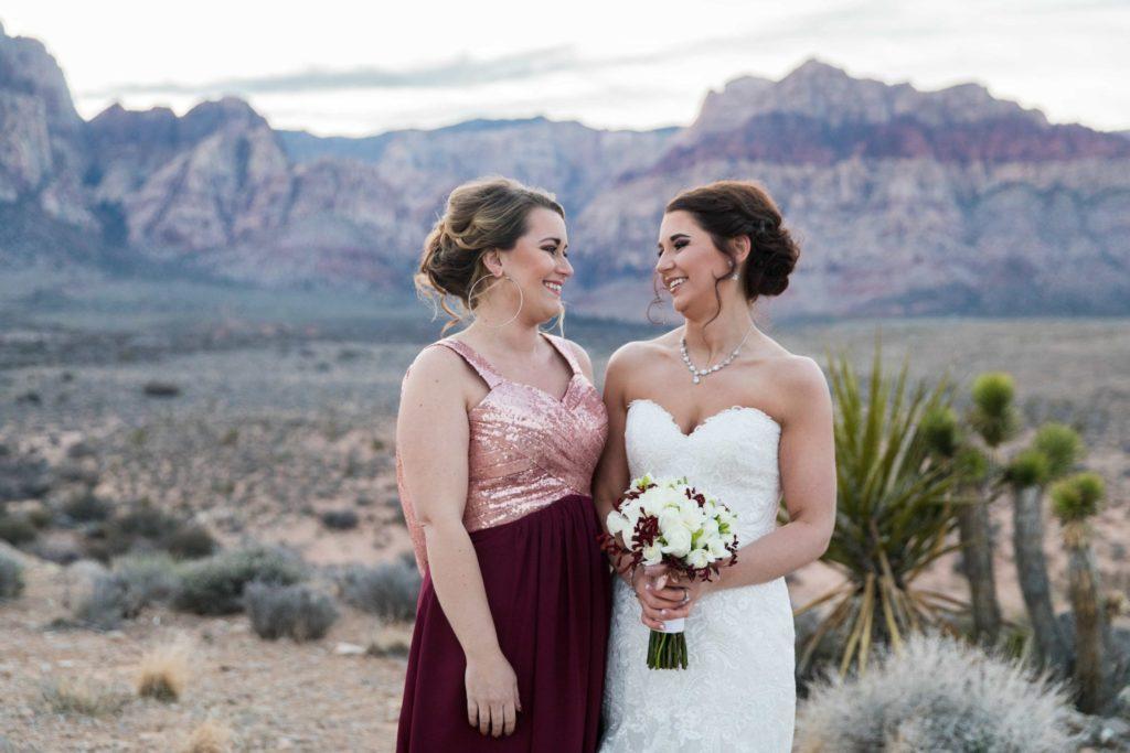 Bride + Bridesmaid in a Summer Weddings in Las Vegas