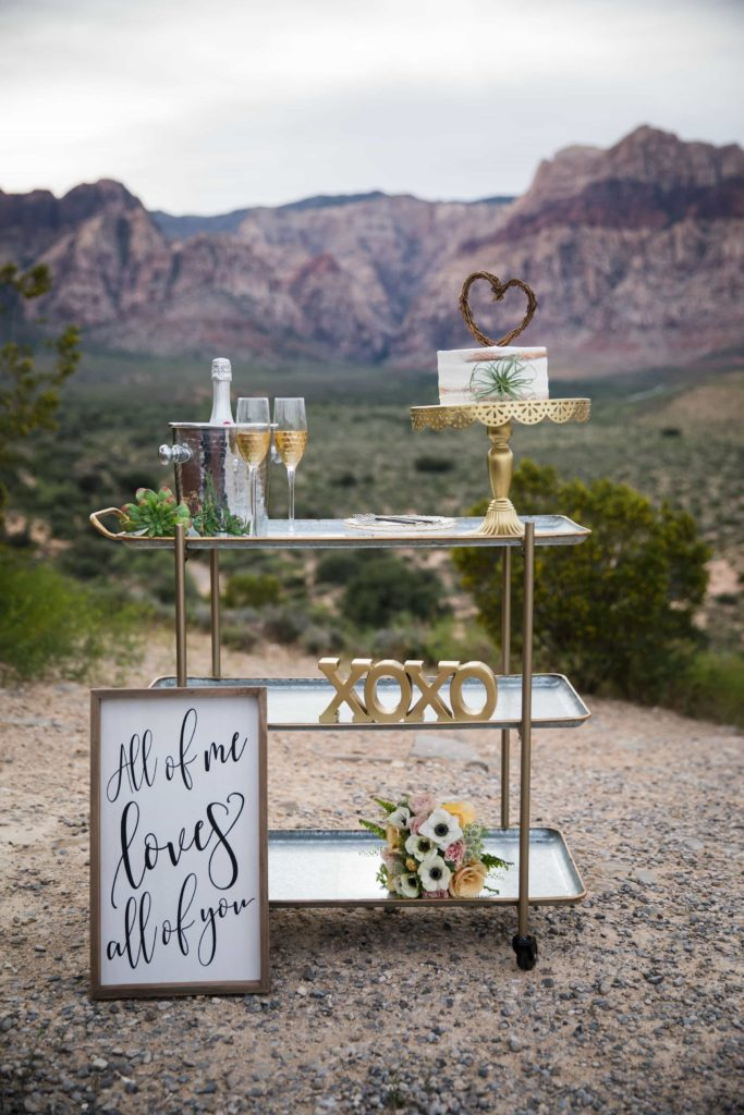 Mini reception set up with sign in front.