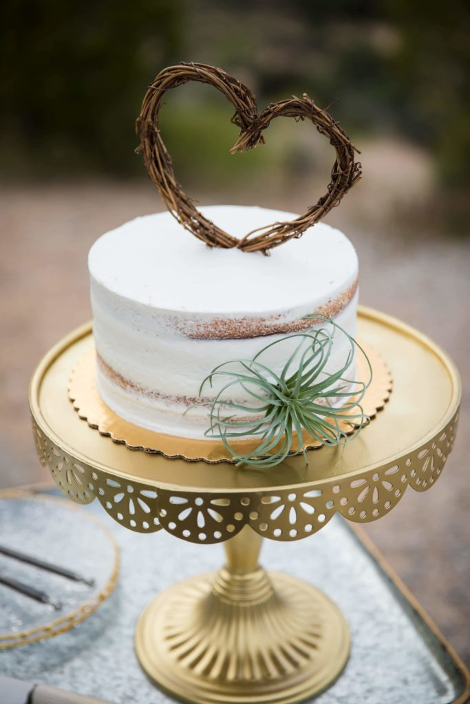 Mini wedding cake with heart topper.