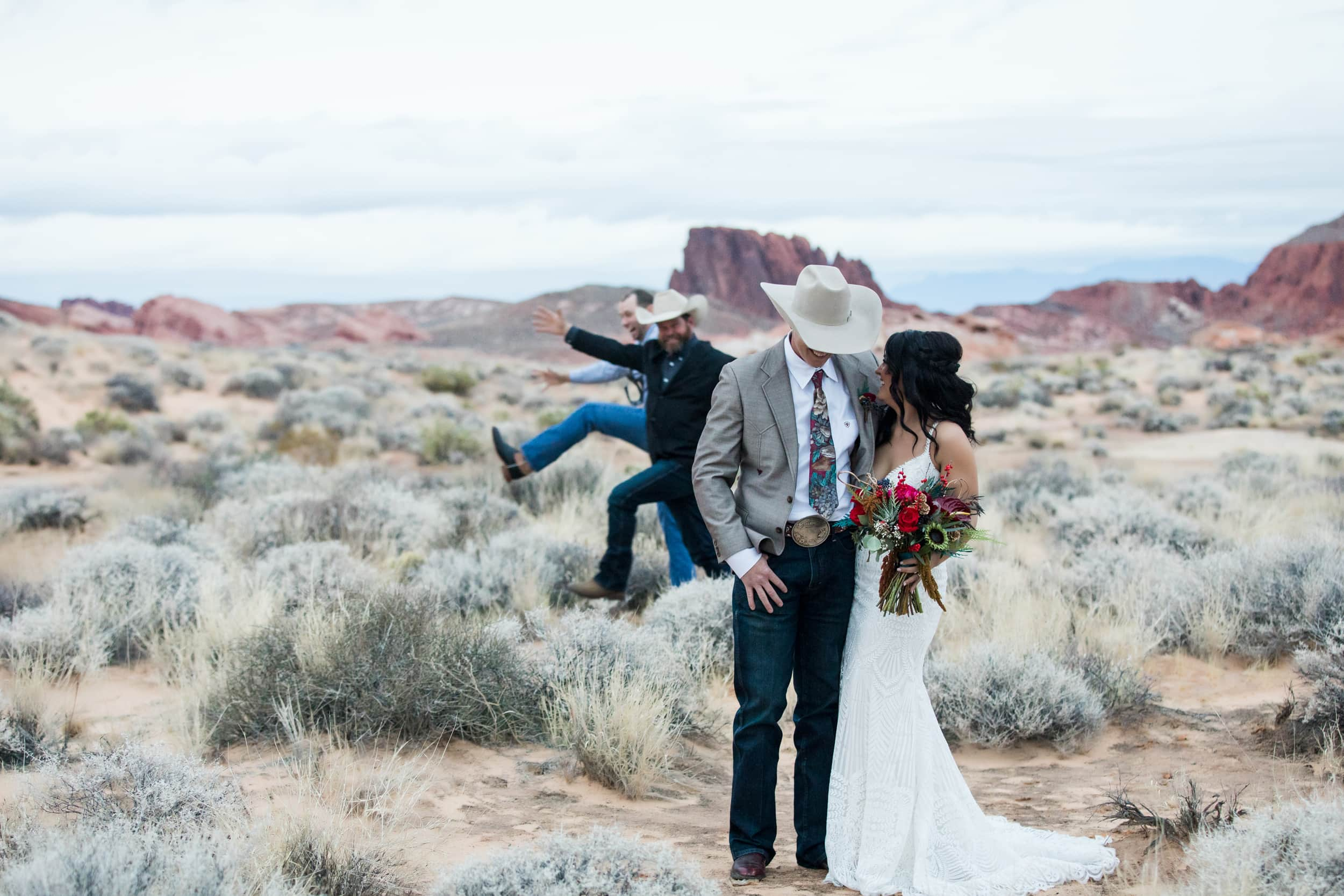 Western wedding party having fun with photo opp.