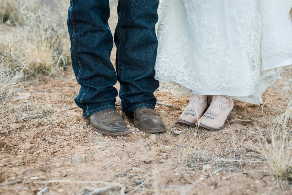 Bride and groom in boots.