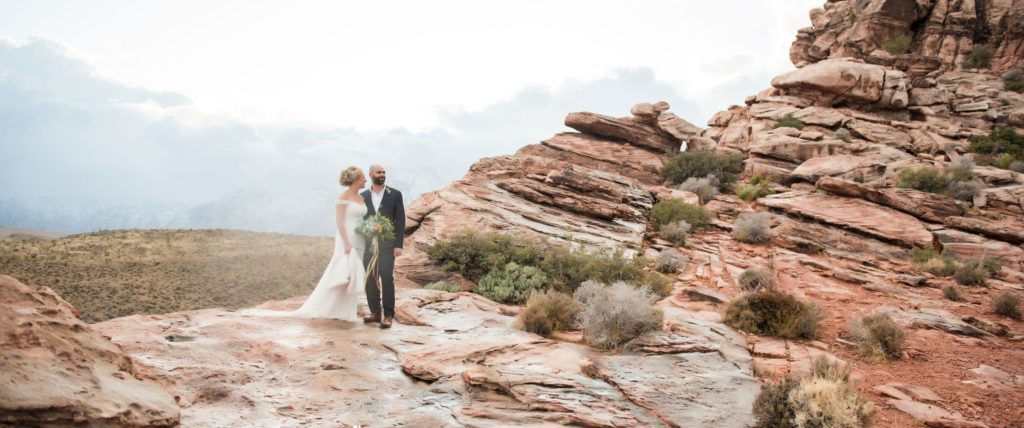 Photo of a bride and groom on the desert mountains in Las Vegas.