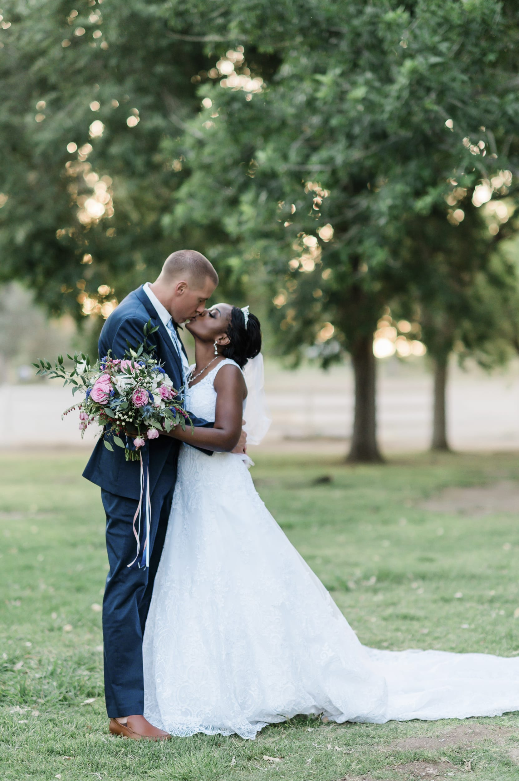 Latashia and Michael kissing for wedding photo.