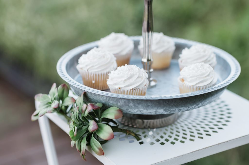 Wedding cupcakes on a platter.