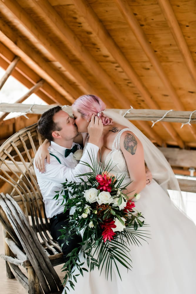 Hayley and Andrew kiss inside the antique barn at Eldorado Canyon.