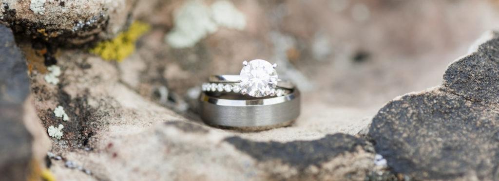 Wedding rings sitting on top of rock.