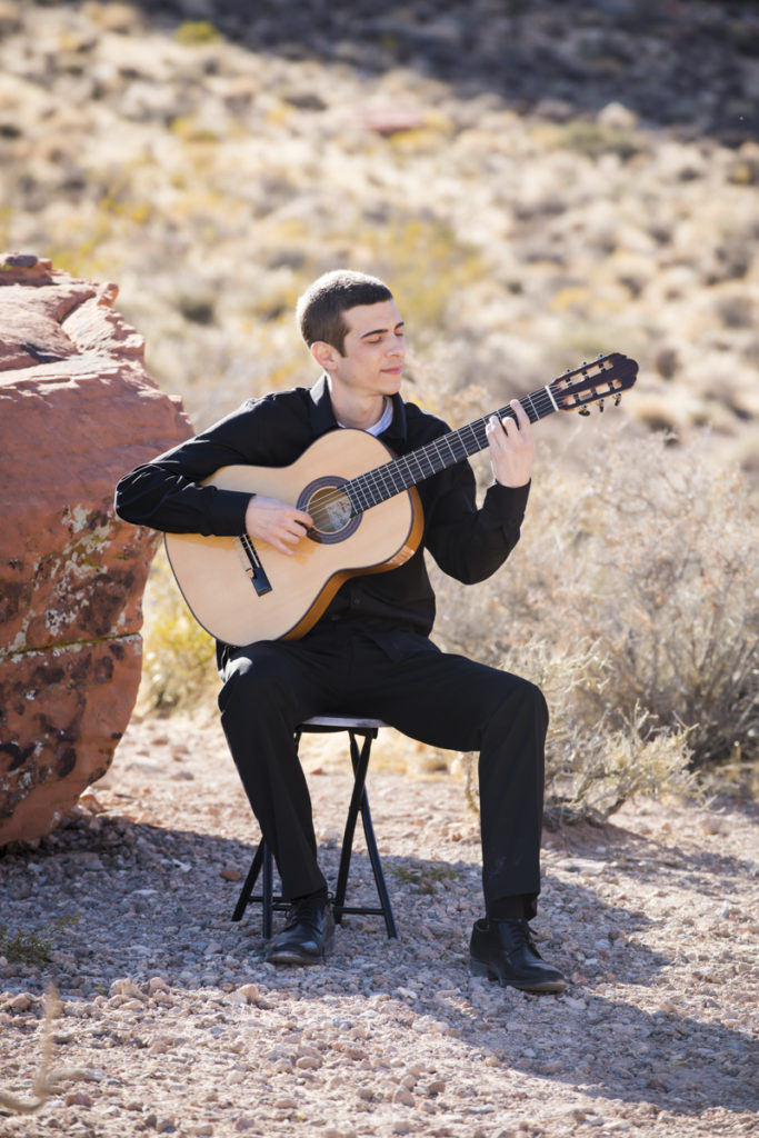Musician playing live acoustic guitar.