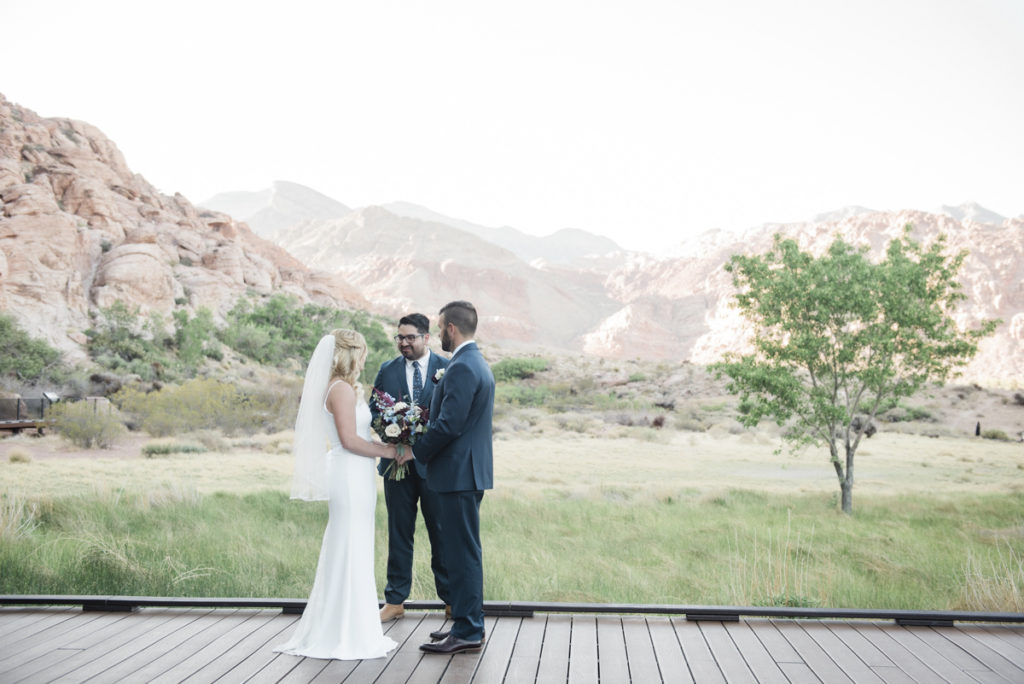 Eloping couple on boardwalk at Red Spring in Red Rock Canyon.