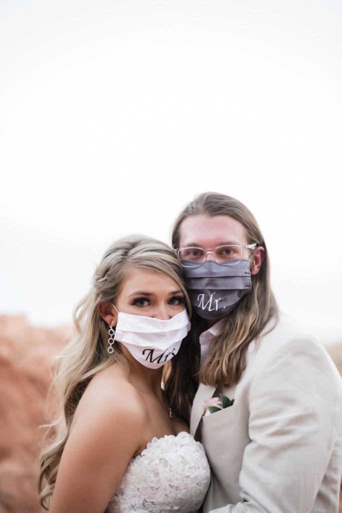 Wedding couple with personalized Mrs. & Mr. masks.