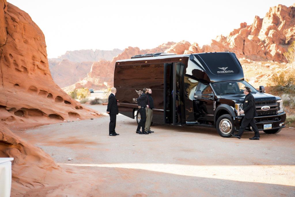 Black van limousine transportation for wedding.