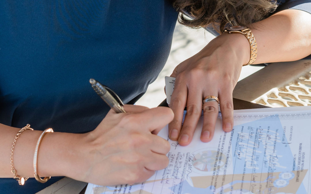 Woman signing San Diego marriage license