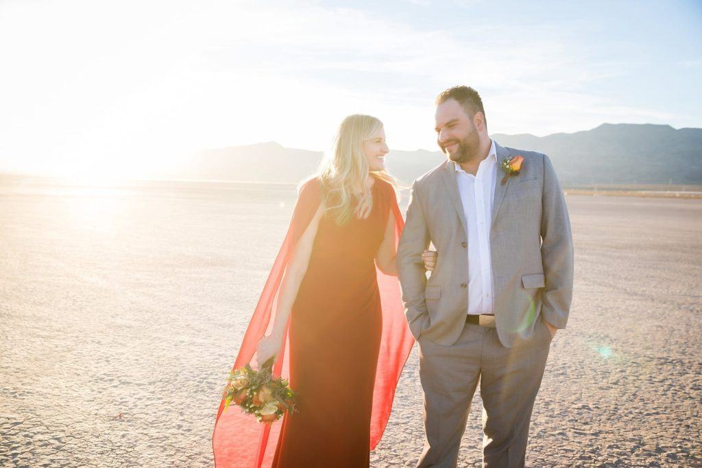 Couple walks hand in hand at sunset in the Dry Lake Bed of Vegas
