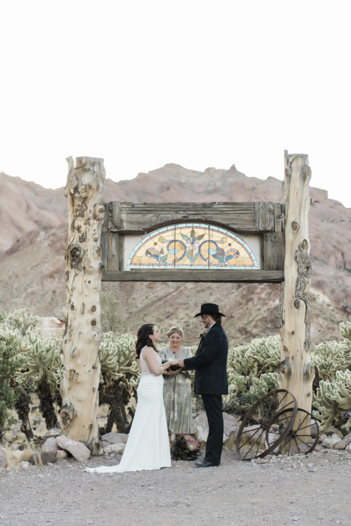 Ceremony in front of stained glass arch