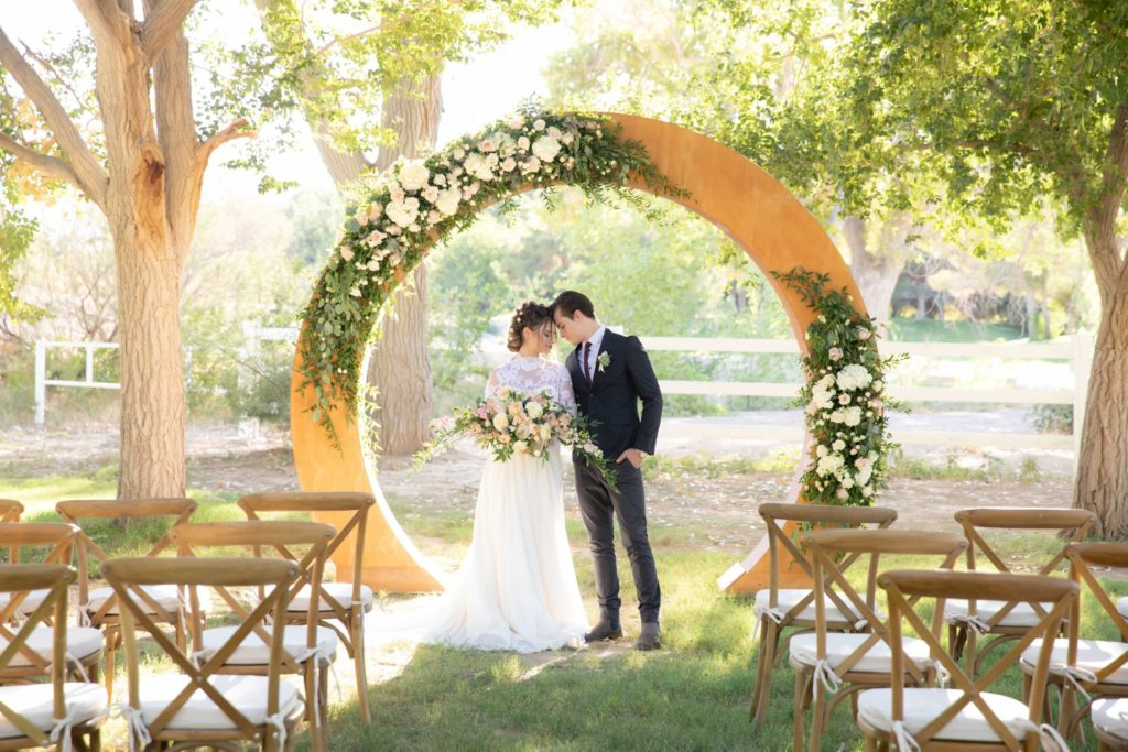 Wedding couple stands at ceremony alter