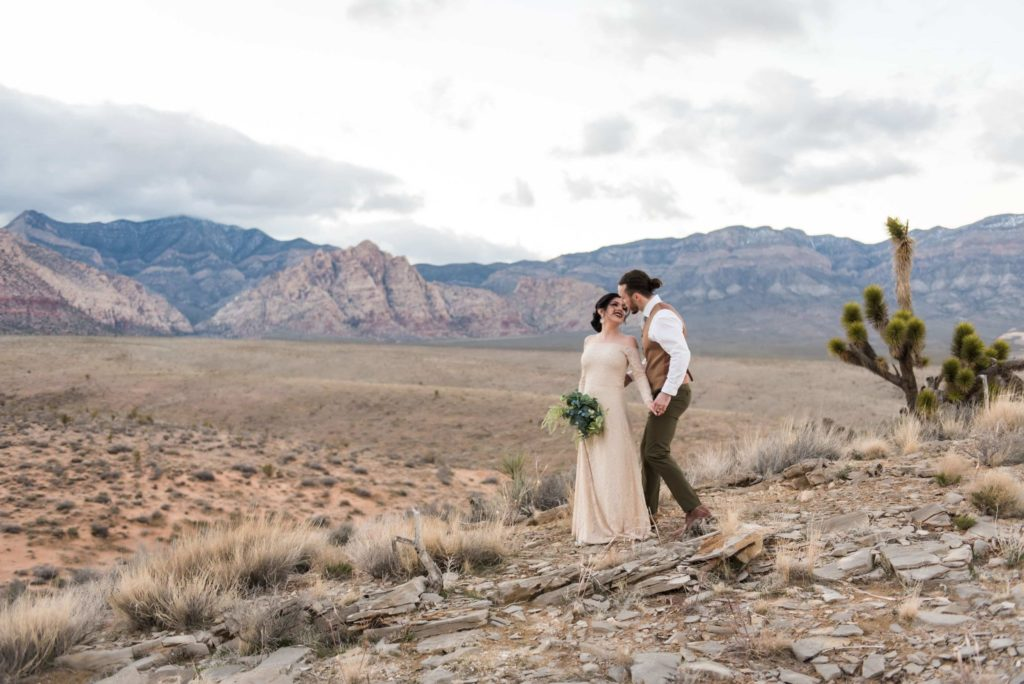Couple standing in front of each other in mountain landscape